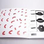 """Detalle del libro """"Hasta el infinito"""". [Descripción de imagen] En páginas interiores, pequeños recortes curvos dejan entrever la página anterior. A la derecha, pequeños trazos y bocas en diferentes aperturas."""