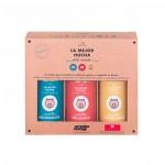 """Vista frontal de """"La mejor hucha del Mundo"""". [Descripción de imagen] Tres huchas de diferente color introducidas en su caja."""