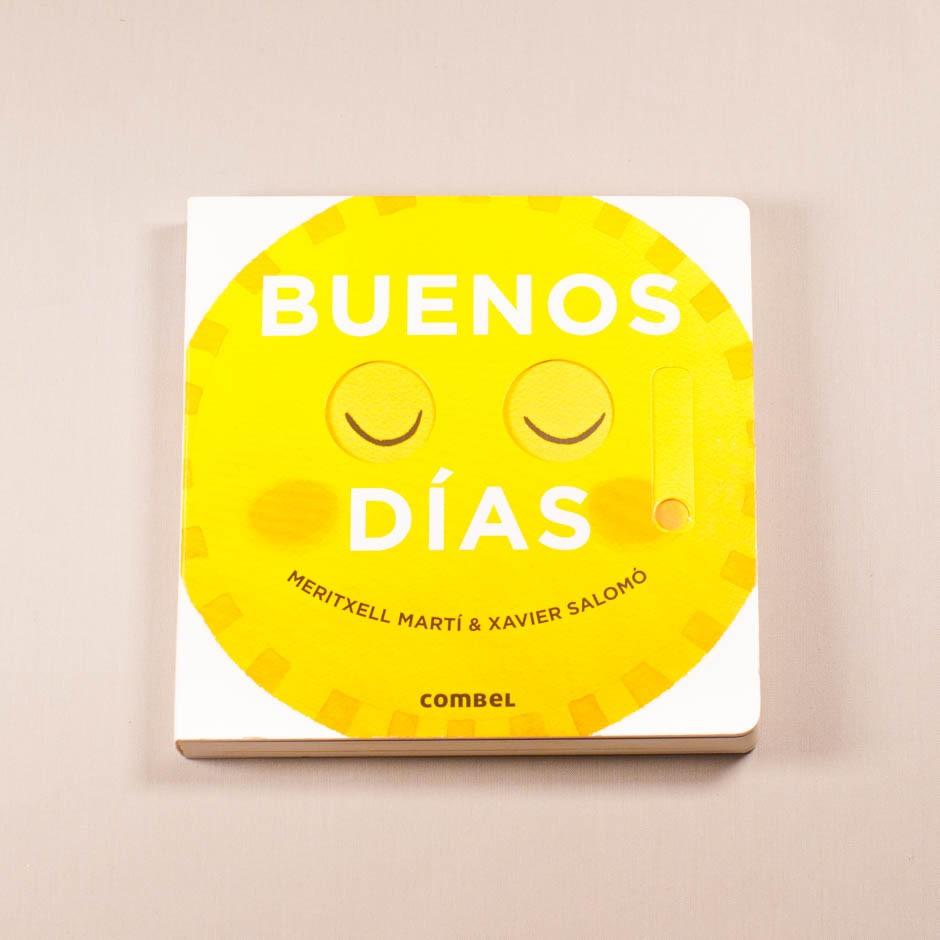 """Vista superior del libro """"Buenos días"""". [Descripción de imagen] En portada, un icono sonriente de ojos cerrados."""