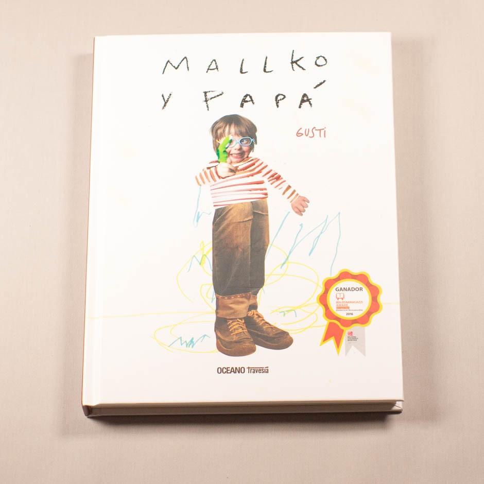 """Vista superior del libro """"Mallko y papá"""". [Descripción de imagen] En portada, el collage de un niño, sobre garabatos de diferentes colores."""