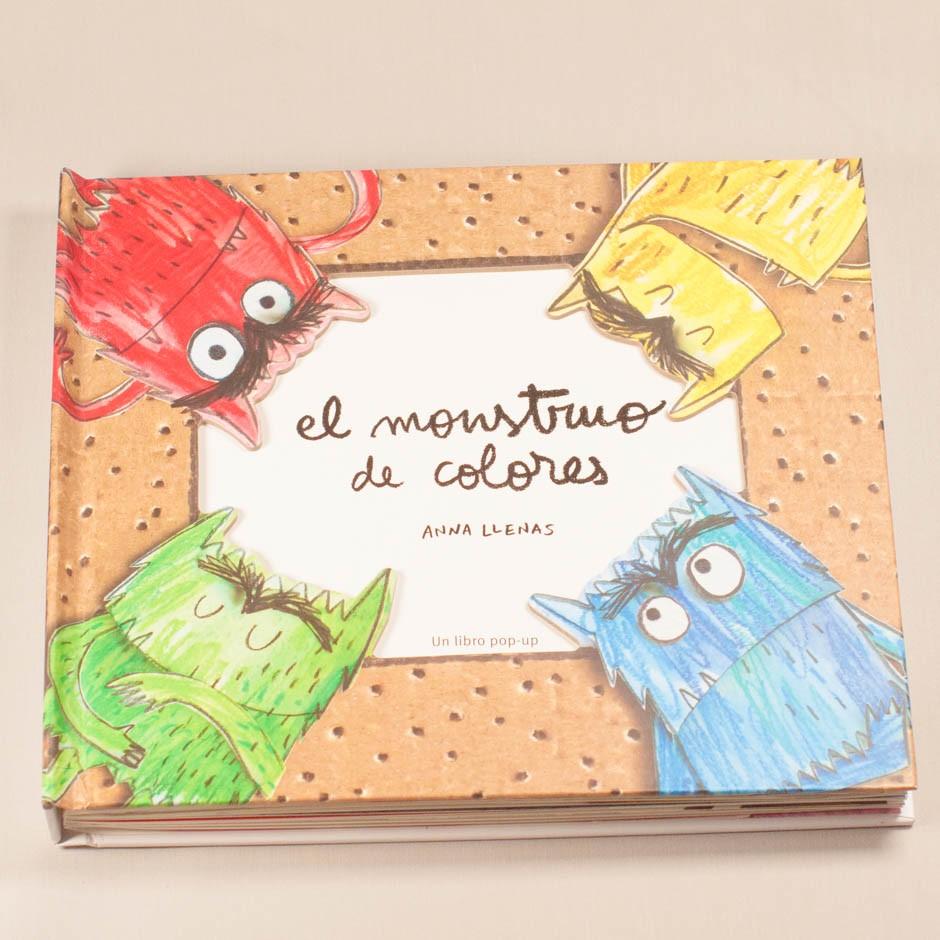 """Libro """"El monstruo de colores"""". En portada, cuatro monstruos pintados en diferentes colores mostrando diferentes emociones."""