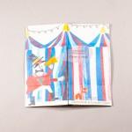 """Libro """"El circo"""". En portada, vista exterior de una carpa de circo. Frente a ella, un personaje diciendo por megáfono: """"Atención, atención. Pasen y vean"""""""