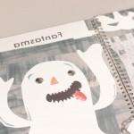 """Detalle del libro """"+ Caras"""". [Descripción de imagen] Un fantasma con las manos alzadas"""