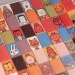 """Detalle del Libro """"Rompecabezas"""". En él, una veintena de diferentes rostros."""